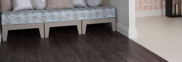 Stone flooring in Admiral Oak and Sift Stone Canvas from Amtico Spacia.