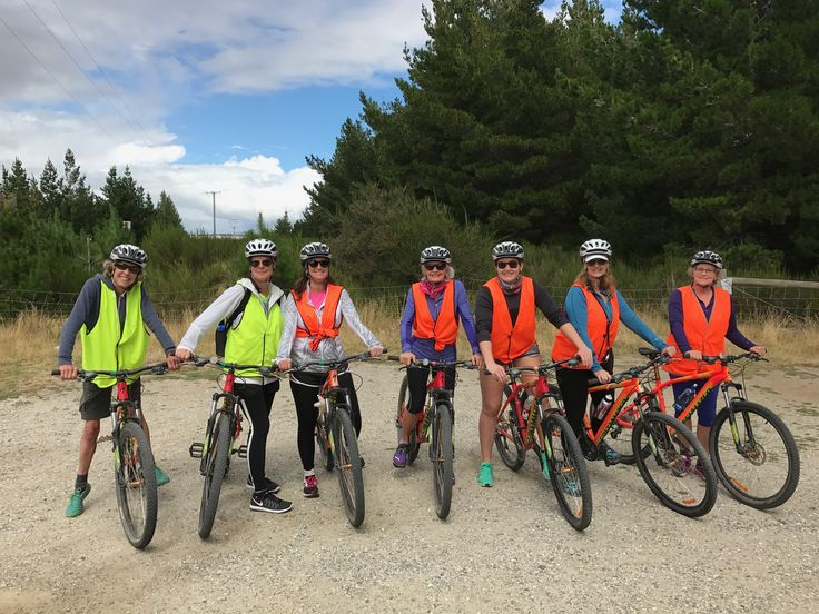 A group of Mountain Bikers pauses for a photo opportunity on the Hawea River Trail.