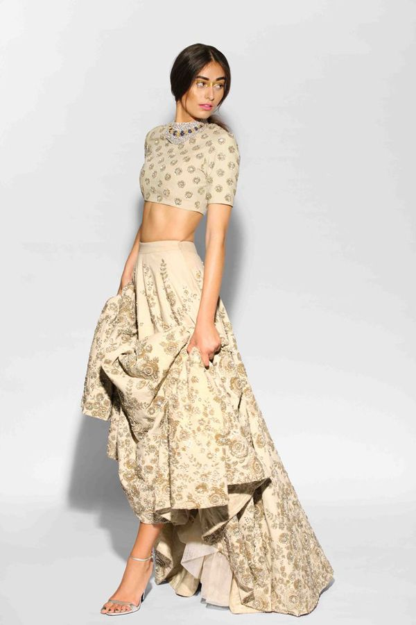 Beige lehenga and crop top embellished with zardozi.