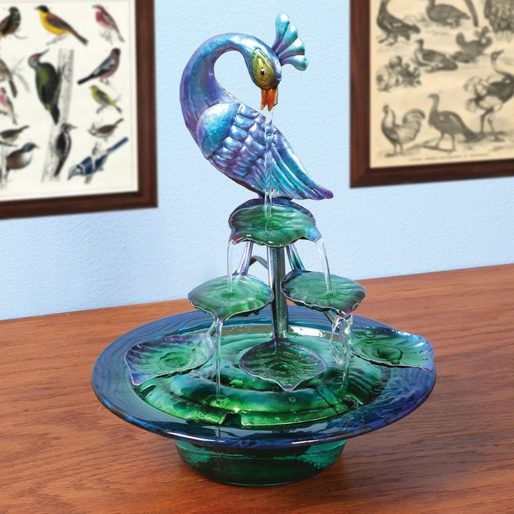 Decorative Glass And Metal Peacock Indoor Water Fountain. Make any room more beautiful with this vibrant peacock fountain. Watch water run out of this peacock's mouth and down two staircases of tail feathers. | eBay!