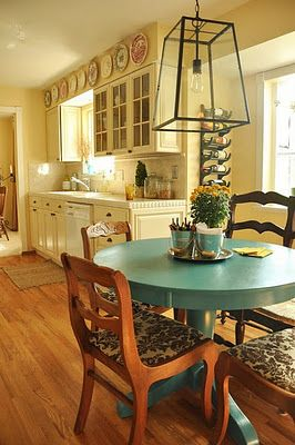 kitchen, plates, painted table, upholstered chairs.