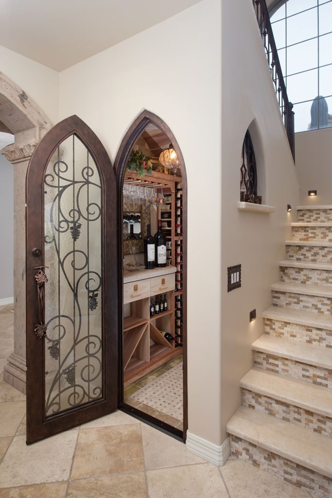 Design-Build Wine Cellar Phoenix with Climate Controlled Wine Cellar with Custom Iron Door.