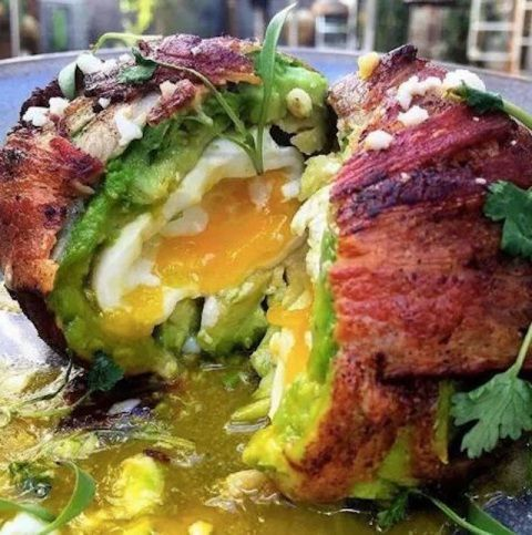 Egg wrapped in an avocado, wrapped in bacon. Yum!