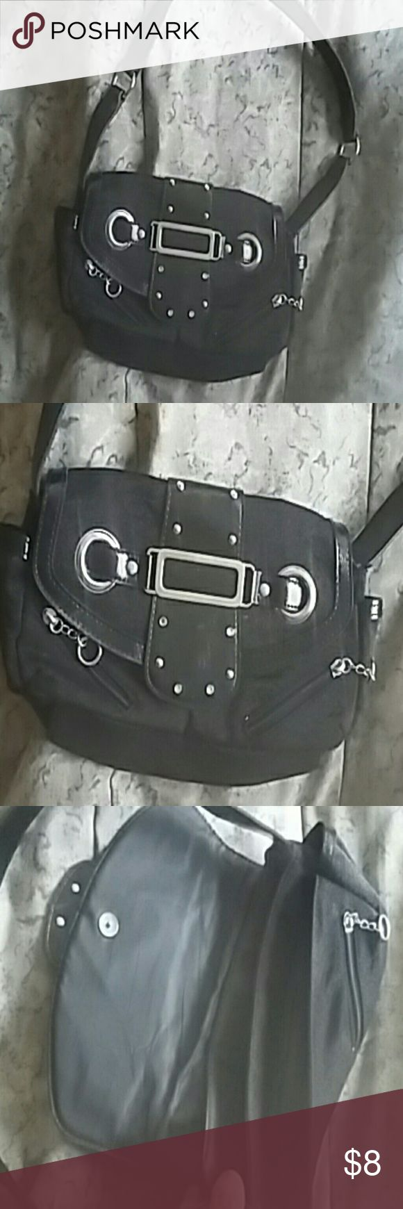Black and silver purse Black shoulder bag,falls just under the shoulder with silver tone detail,10W,7L,strap 24 L around,snap closure Bags Shoulder Bags