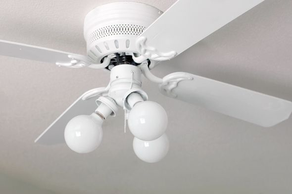 Spray-painting ceiling fans: take it apart, tape off the electric parts, then give it two coats of spray paint (she used semigloss). That's it!