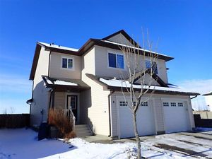 NO CONDO FEES: Gorgeous Fort Sask Duplex, steps from the parks