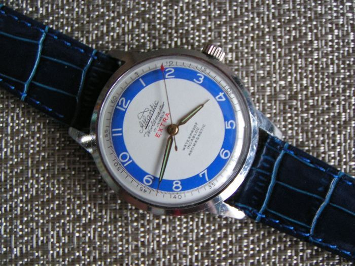 Atlantic WARLDMASTER  Type: Man's/Unisex  Anti-shock system: Incablock  Mechanism: Hand-wound, Swiss Made, 17 Jewels, ETA 1100  Case's type: Chromed  Dial's colour: White with a blue ring Glass: Plexi  Strap's type Leather (Atlantic) Strap's colour: Blue 19 mm Clasp: Silver Case's width without the crown: 37.00 mm  Case's thickness: 11.00 mm   The watch is from the 50s.   The watch has a uniquely accurate and durable Swiss mechanism ETA 1100, 17 jewels  Chrome...