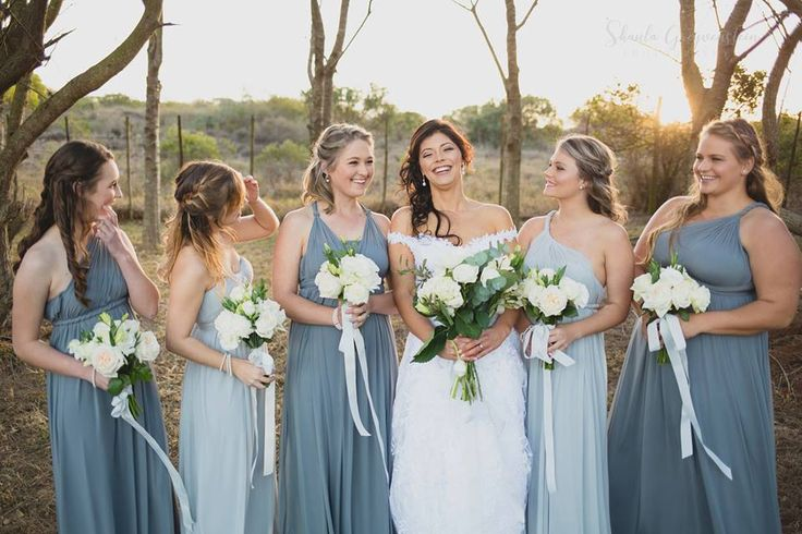 Bride and bridesmaids, share this happy occasion together.