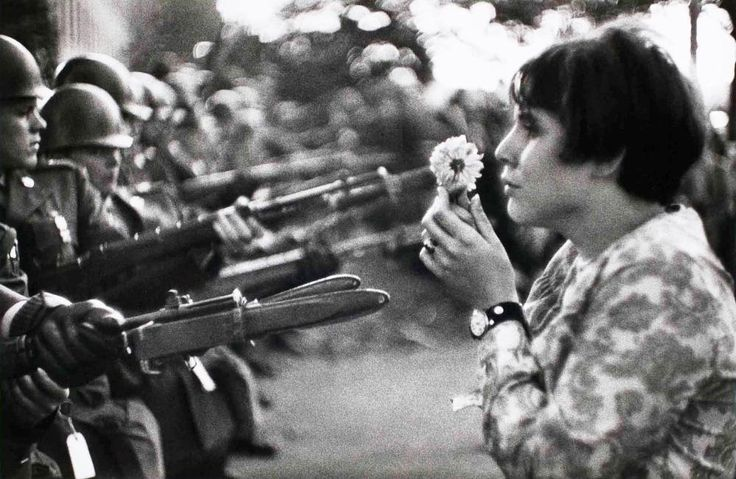 Iconic photographs: Anti-Vietnam War March 'Flower Girl', Marc Riboud, 1967