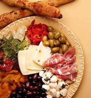 Antipasto platter- in the bar room so people can snack before/after buffet line.   Get small paper plates/toothpicks/napkins