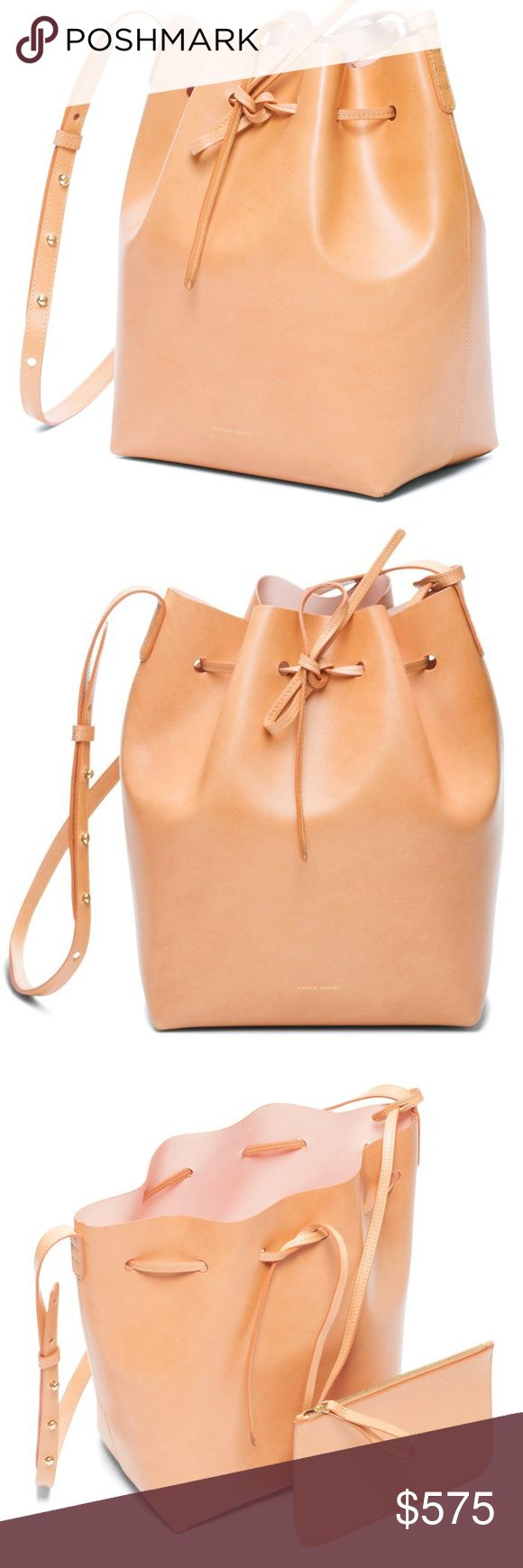 Mansur Gavriel Large Bucket Bag Camello Like New Mansur Gavriel Large Bucket Bag Camello Like New Carried only twice then received the black version. I adore this bag but wear way more black and can't justify two! There are a few little marks (will post pics soon) but those are characteristic of this bag and will continue to happen, only making it look more street-stylish as you wear it in! In like new condition and includes zip pouch and dust bag. Mansur Gavriel Bags