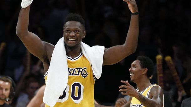 #NBA   Los Angeles Lakers forward Julius Randle (30) and guard Louis Williams (23) celebrate after the Lakers defeated the Golden State Warriors 117-97 in an NBA basketball game in Los Angeles, Friday, Nov. 4, 2016. (AP Photo/Alex Gallardo)