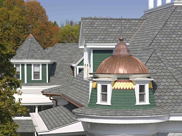 Timeless, covetable curb appeal. Renovated 113-year old home in south Haven, Michigan featuring Carriage House Shingles.