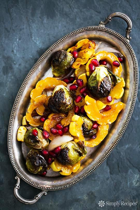 Maple syrup roasted delicata squash and brussels sprouts, with shallots and pomegranate seeds. So festive! Perfect side for Thanksgiving. ~ SimplyRecipes.com
