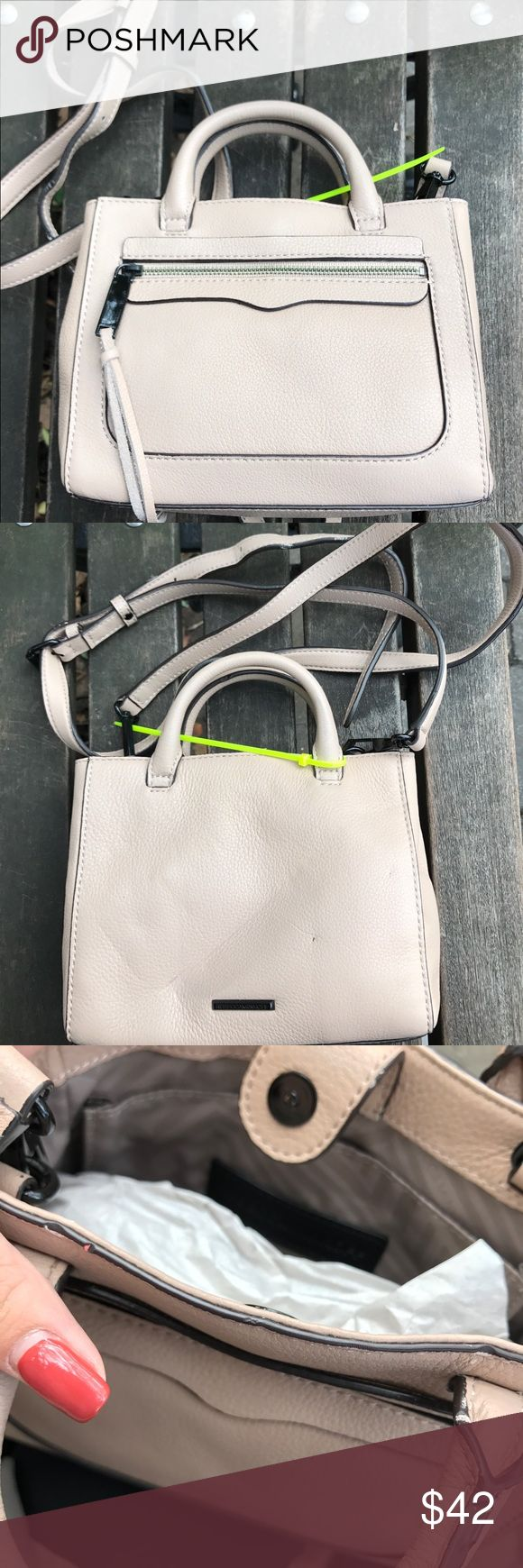 "Rebecca Minkoff Nude Avery Crossbody Purse Brand new and unused. Purchased from a sample sale, so no tags because this is a sample bag (has sample tag on the inside). There are several minor flaws (black and white marks) and creases on this bag but it doesn't take away from the overall function of the bag. However, the long strap is not fully ""straight,"" I would suggest mainly using this bag with the shorter handle but with include the long strap. Message me for any questions. Rebecca…"