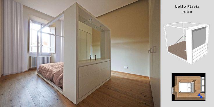Un letto a baldacchino moderno posizionato al centro stanza. E dietro la parete di testata si nasconde il como'. Design Artigianale by JFD.