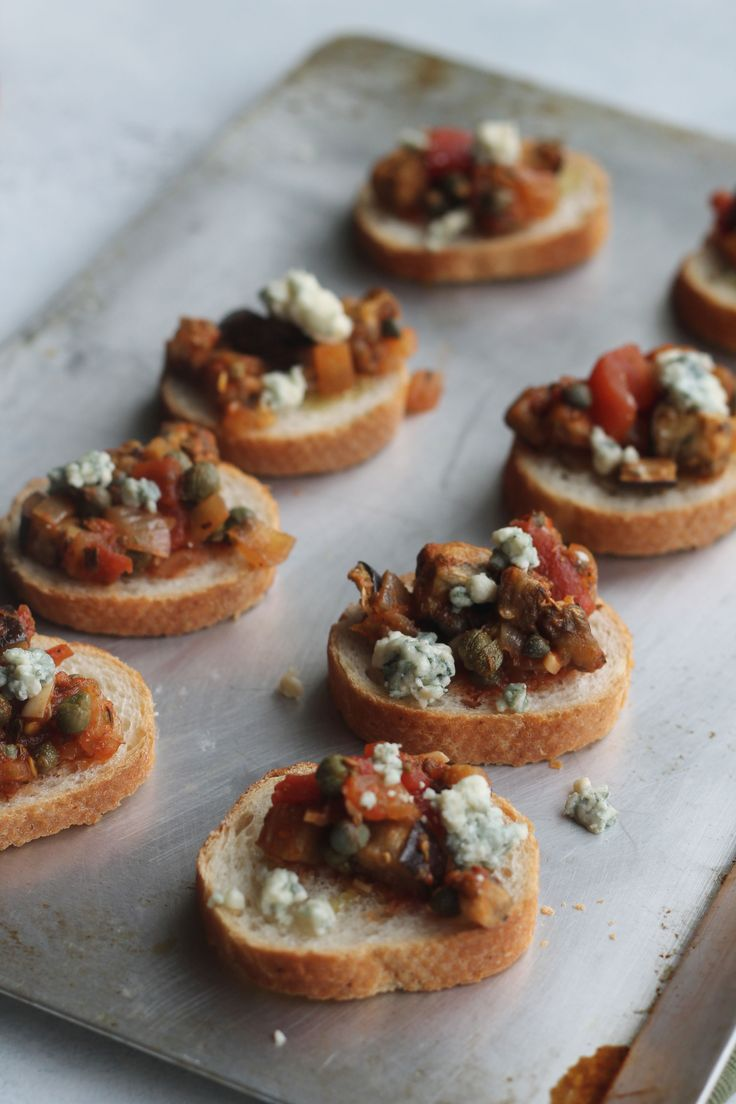 Bruschetta with eggplant, capers and blue cheese crumbles make this the perfect appetizer