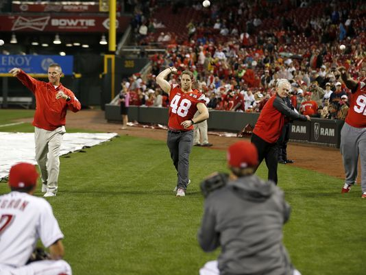Urban Meyer among All-Star Celebrity Softball additions. Photo: (Left to right) Ohio State football coach Urban Meyer, linebacker Joe Burger, a La Salle High School alumnus; Ohio State assistant coach Kerry Coombs and defensive lineman Adolphus Washington, a Taft High School alumnus, throw out the ceremonial first pitch ahead of the Reds' Opening Night game against the Pittsburgh Pirates on April 8. The Enquirer/Kareem Elgazzar