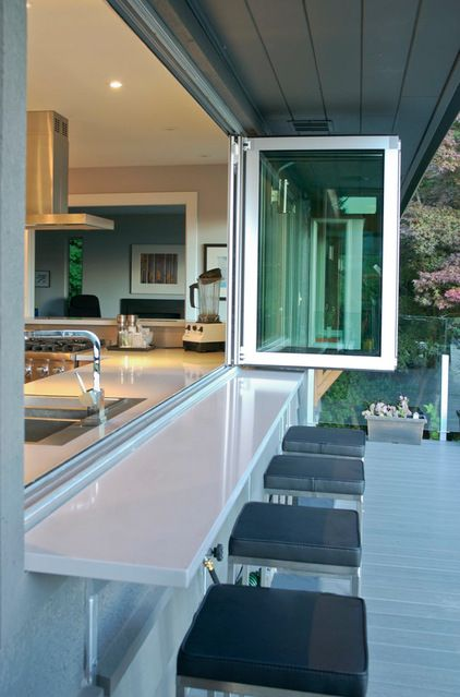 "Folding windows by NanaWall connect the indoor and outdoor entertaining areas. ""Hands down, our favorite feature of the house is the view and connection to the outdoor spaces."