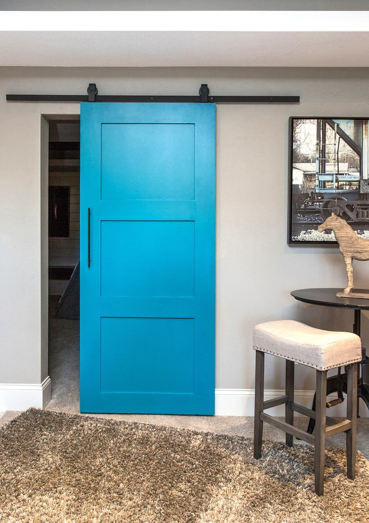 The 3-Panel Barn Door is a contemporary look on the classic 6-Panel Barn Door, perfect for any home decor. As Pictured: Paint Grade Solid Door + Custom Teal Paint + Top Mount Barn Door Hardware. Lead