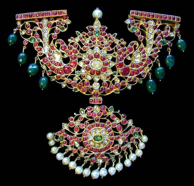 Makara Kanti India; Tamil Nadu 18th c. 22K Gold on SS, Rubies, Diamonds, Emeralds, Basara Pearls Length: 48 cm, Width: 16 cm.