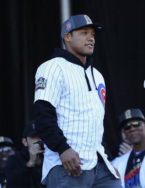 Addison Russell of the Chicago Cubs smiles at the crowd during the Chicago Cubs victory celebration in Grant Park on November 4, 2016 in Chicago, Illinois.