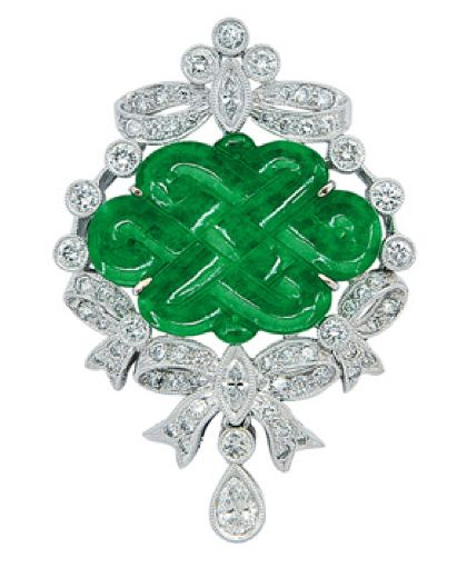 A Jadeite and Diamond Pendant   Centering a jadeite endless knot plaque amid round and marquise-cut diamond ribbons, and suspending a pear-shaped diamond drop, mounted in 18k white gold