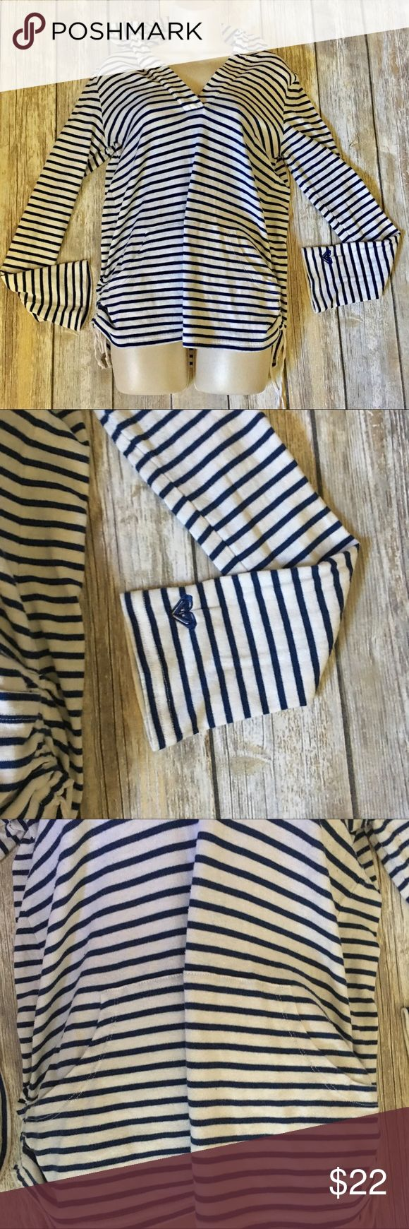 🍒Roxy Stripped Hooded Sweater Beautiful light sweater with hood. . Ties on sides has single hand pocket. Size large. In excellent used condition. Blue and white in color. Flattering v neck line. Roxy Tops Sweatshirts & Hoodies