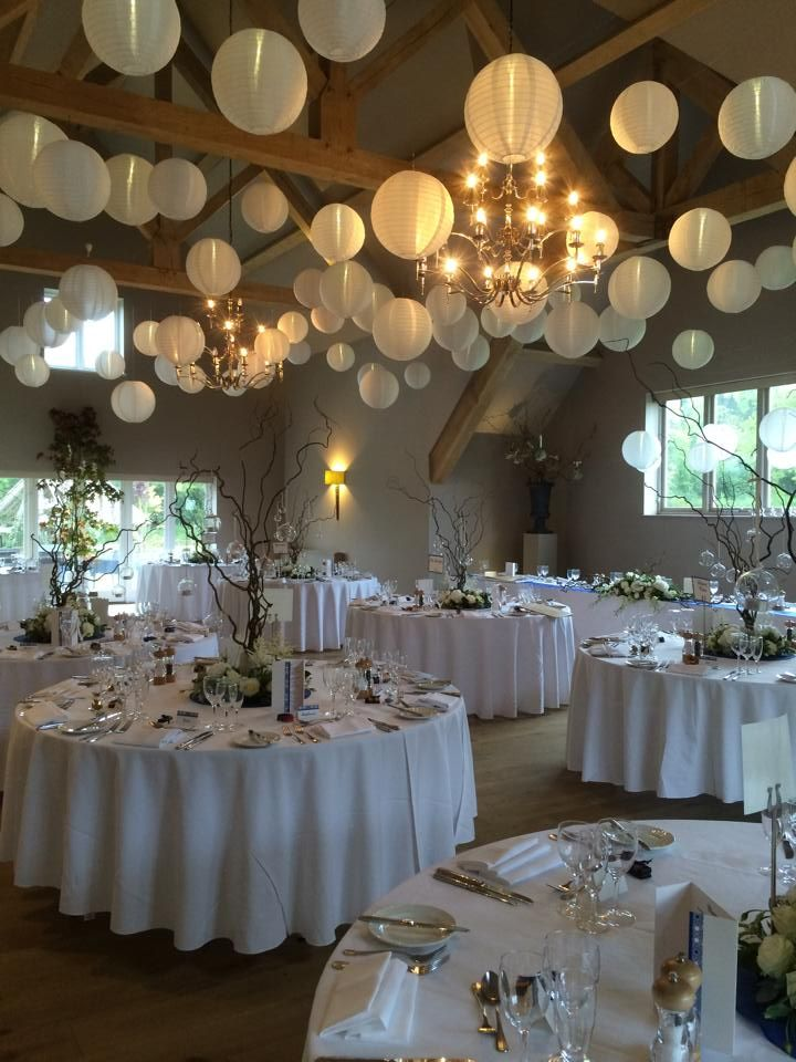 Hanging lantern installation with lace lanterns for a wedding at Hyde Barn - Stow on the Wold. Blue, pink and white lanterns
