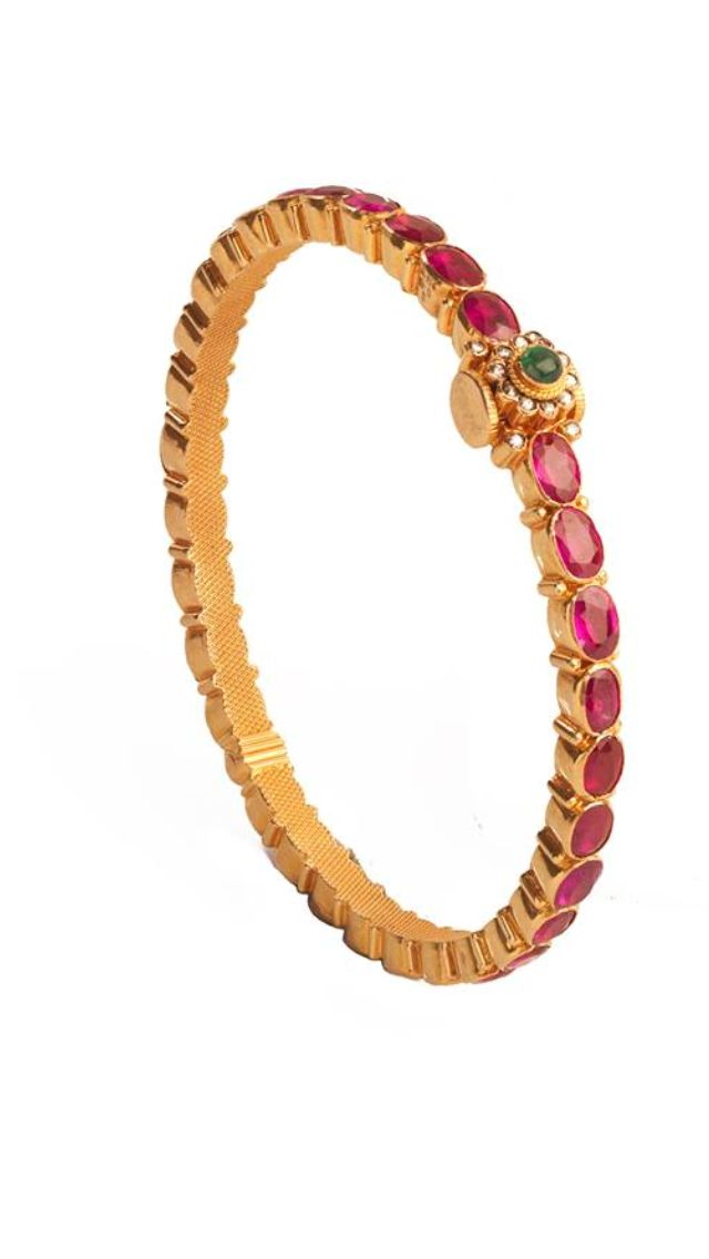Ruby & gold bangle. Shop for your wedding jewellery with Bridelan - a personal shopper & stylist for weddings, also a resource for finding rare jewels of India. Website www.bridelan.com #Bridelan #southindianjewellery
