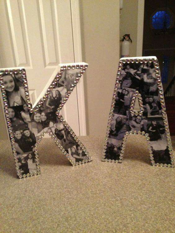 Make your own photo collage letters with modge podge and cardboard letters from the craft store.