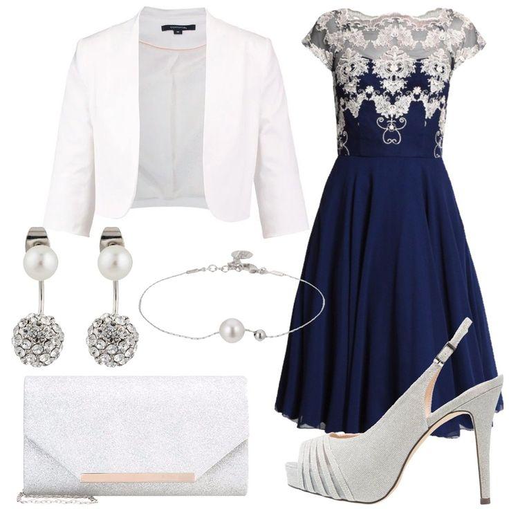Outfit adatto ad una serata romantica. L'abito blu è in chiffon blu, dal taglio corto molto elegante con decorazioni in pizzo bianco. Viene completato dalle scarpe e dagli accessori come la clutch, il bracciale e gli orecchini nelle varianti argento con piccoli dettagli in perla.