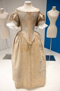 Silver tissue dress trimmed with cream parchment lace, English, c. 1660.