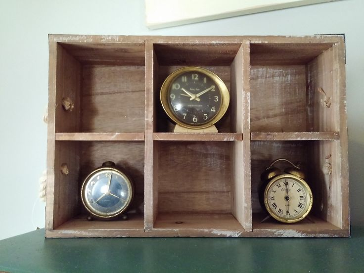 A primitive wood crate with old small wind up alarm clocks inside it.#farmhouse #farmhousestyle #farmhousedecor #farmhousedecorating #homedecorating #homedecor #homedecorideas #home #randomroosterfarm #clock #morning #crate #alarm #time