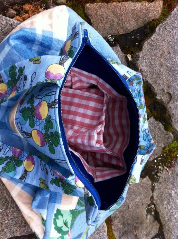 Turnip bag with inner pockets, including a lipstick pocket
