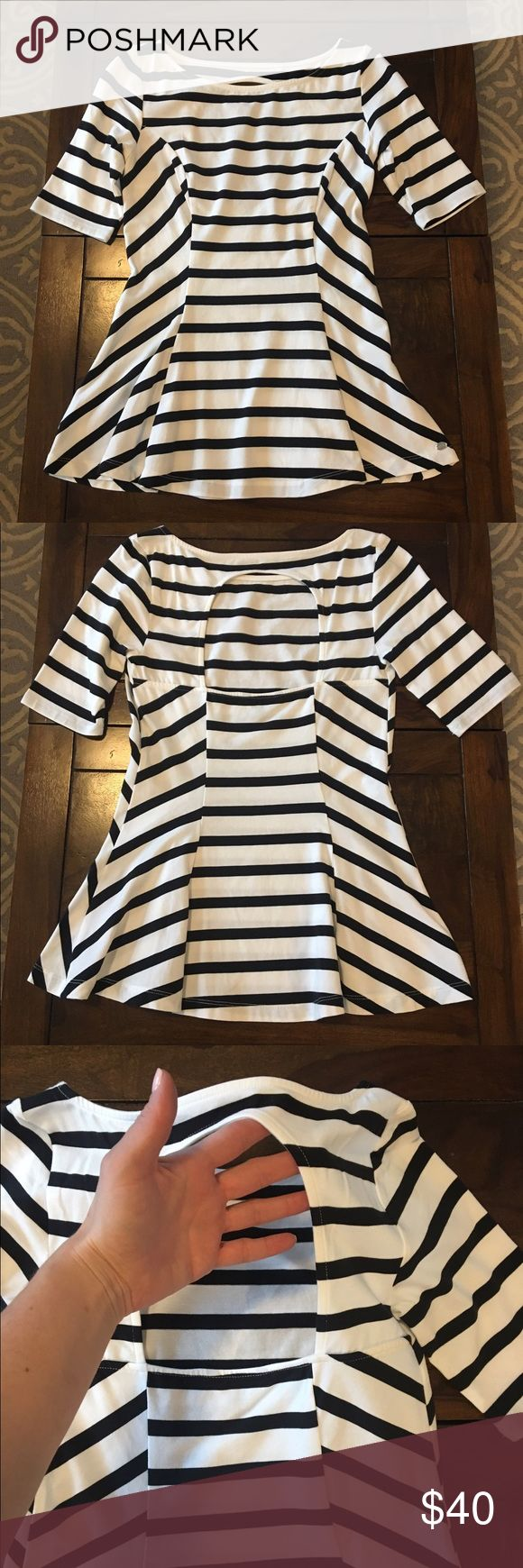 NWOT Guess white and black stripe peplum top NWOT- never worn.  Guess black and white peplum top with cut out back design. Guess Tops Tees - Short Sleeve