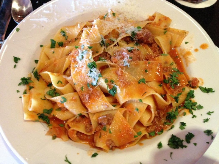 Pappardelle alla Bolognese - homemade wide noodle pasta in an imported ...