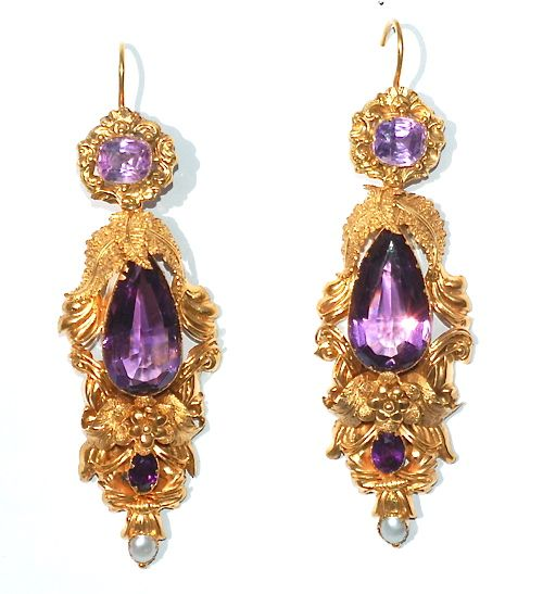 Victorian Repousse Earrings, circa 1840. The technique of repousse involved shaping flat sheets of gold into various designs. In this case the repousse is of entwined foliage and floral motifs. The earrings are set with faceted amethysts and pearls. As the earrings have been made from sheets of gold, they are as light as a feather on the ear.