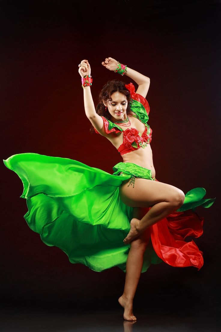 professional dancer beautiful woman dancing in green and red costume on black