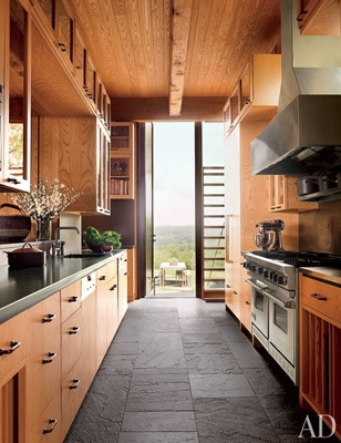 """""""Art Barn"""", NY: love the natural wood and slate gray flooring with modern appliances. Got to love that open view at the end of the galley kitchen too!"""