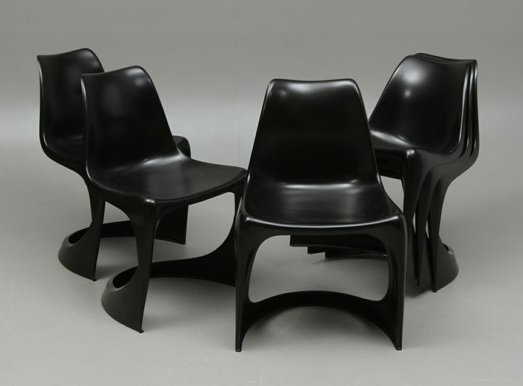 The 290 chair designed by Danish designer Steen Ostergaard, the worlds first injection molded chair in one piece, designed in 1966, comfortable and beautiful - Black Beauty