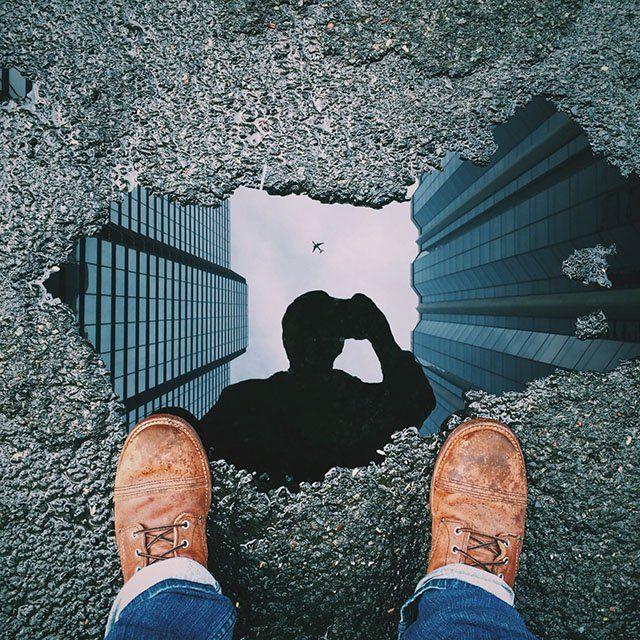 Unplanned: is captured through this spontaneous photo by the utilization of a birds eye perspective, and reflection to capture the photographer along with a framed composition