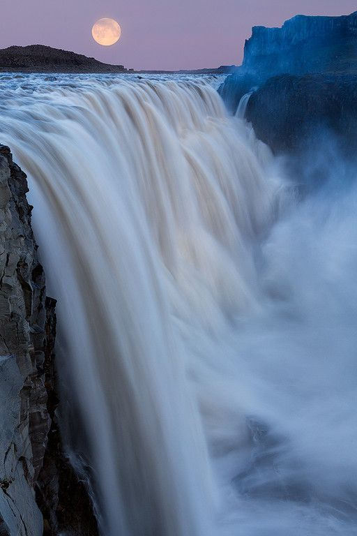 A super moon over the most powerful waterfall in Europe, Dettifoss, Iceland.