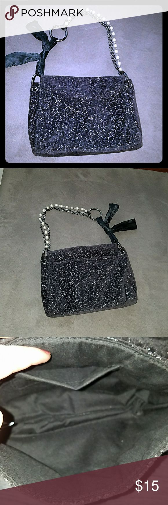 *SALE* EUC Small Black & Silver GAP Purse EUC small black and silver GAP purse with a beaded strap. Also has a black bow accent on the strap. Magnetic closure with one small side pocket on the inside. 9 in x 6 in. with a 7 in. handle drop GAP Bags