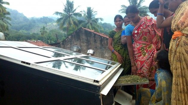 Chintapakka Jambulamma, 34, looks admiringly at a solar dryer. It's the prized possession of the Advitalli Tribal Women's Co-operative Society- a collective of women entrepreneurs that she leads.  Read more: http://www.ipsnews.net/2014/03/sun-shines-forest-women/