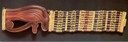 Thirteen bracelets were placed on the forearms of Tutankhamun's mummy, seven on the right and six on the left. Apart from these thirteen, there were other bracelets among the mummy wrappings and elsewhere in the tomb. This bracelet was placed on the right forearm, near the elbow. It's band is composed of nine rows of gold, faience, and glass beads threaded between six gold spacer bars that resemble the gold beads and keep the nine rows in position. The clasp, which is like a pegged mortise…