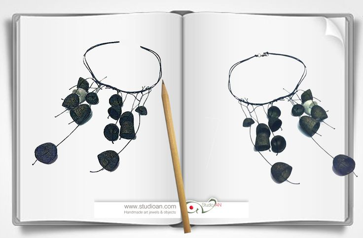 Necklace made of paper and dark olive silk cocoons  #studioAN #papernecklace #handmade #paperart #paperlove http://www.studioan.com/ngine/en/product/141/necklace-made-of-paper-and-dark-olive-silk-cocoons