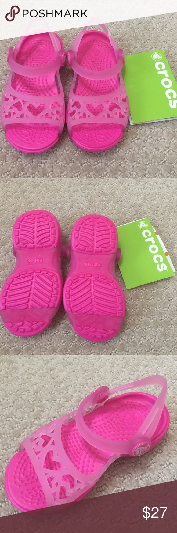 Super Cute CROCS Sandals for Toddler Brand new, hard to find CROCS sandals. Toddler size. Cutout heart detail. Super cute!! Your little baby girl will look adorable in them!! *no holds, no trades, no modeling* CROCS Shoes