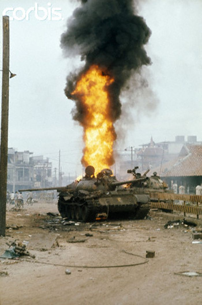 Russian/Chinese T-54 NVA tank burns. 30 Apr 1975, Saigon, Vietnam --- Fights break out between South and North Vietnamese troops in Saigon. --- Image by © Jacques Pavlovsky/Sygma/Corbis