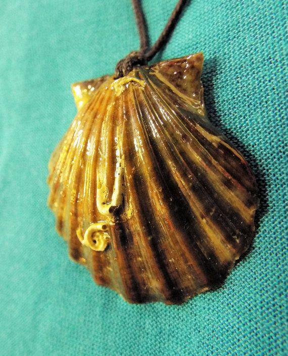 Handmade real scallop seashell pendant with dark earthy tones.
